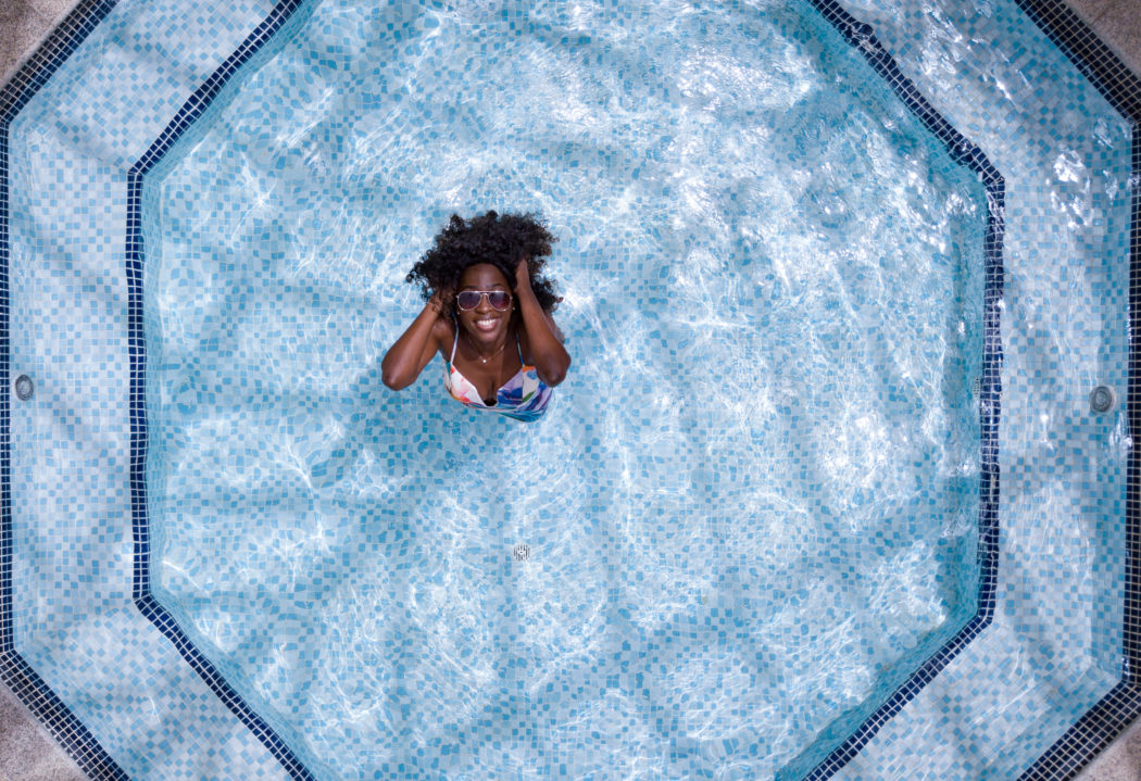 Canva – Aerial Photo of Woman Wearing White and Blue Bikini Top Standing on Swimming Pool (2)